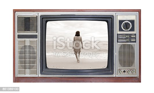 istock Retro television on white background with image alone woman on beach on screen. 851389100