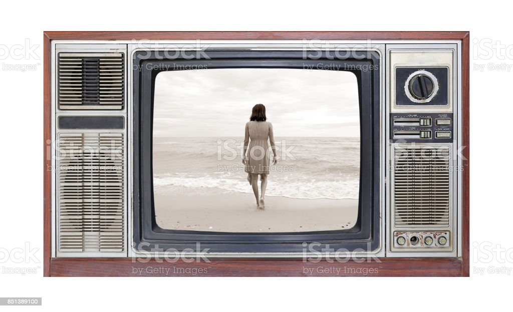 Retro television on white background with image alone woman on beach on screen. stock photo