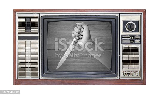 istock Retro television on white background with image of hand holding knife on screen. 697208112