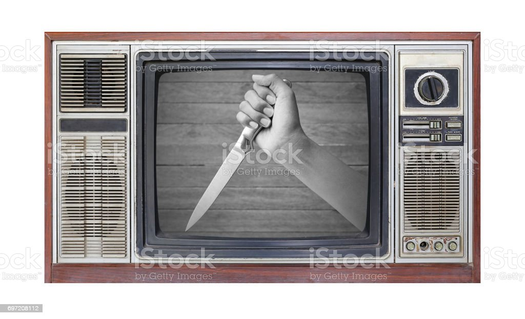 Retro television on white background with image of hand holding knife on screen. stock photo