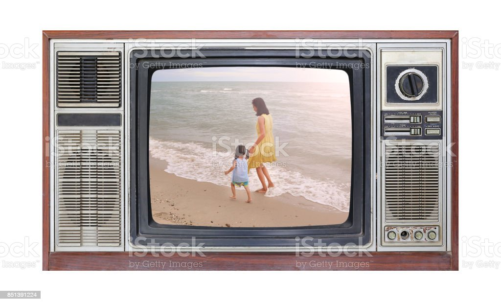 Retro television on white background with image of mother and child on the beach on screen. stock photo