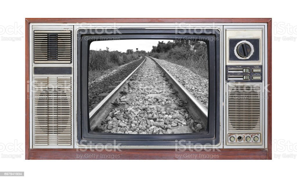 Retro television on white background with image of railroad track on screen. stock photo