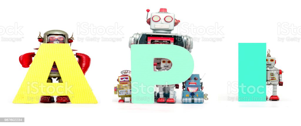retro tin robot toys hold up the acronym API isolated stock photo
