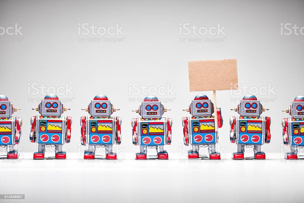 Muffins anglais rétro robot tenant un panneau - Photo
