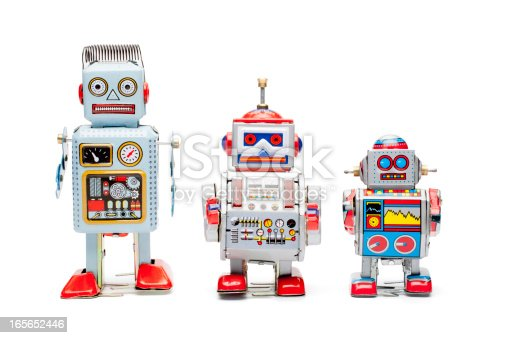 Retro tin robots isolated on white.