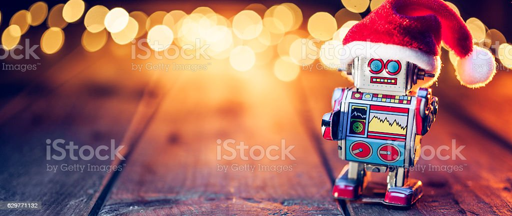 Retro tin toy santa robot - Wood Christmas Table Lizenzfreies stock-foto