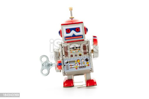 Retro tin robot isolated on white.