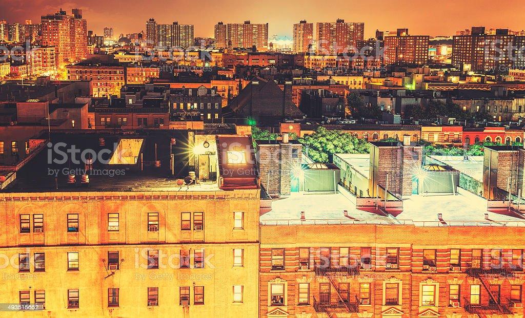 Retro toned Harlem neighborhood at night, NYC, USA. stock photo
