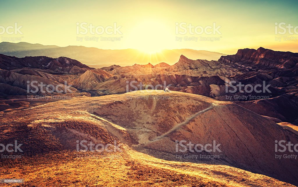 Retro toned sunset over Zabriskie Point, Death Valley, USA. stock photo