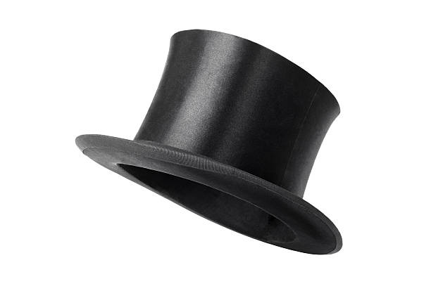 retro top hat ready to wear on white background - magician stock photos and pictures