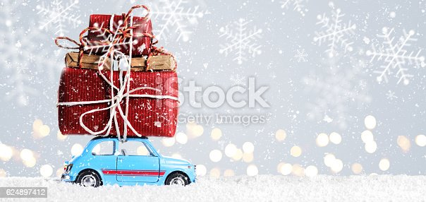 istock Retro toy car with christmas gifts 624897412