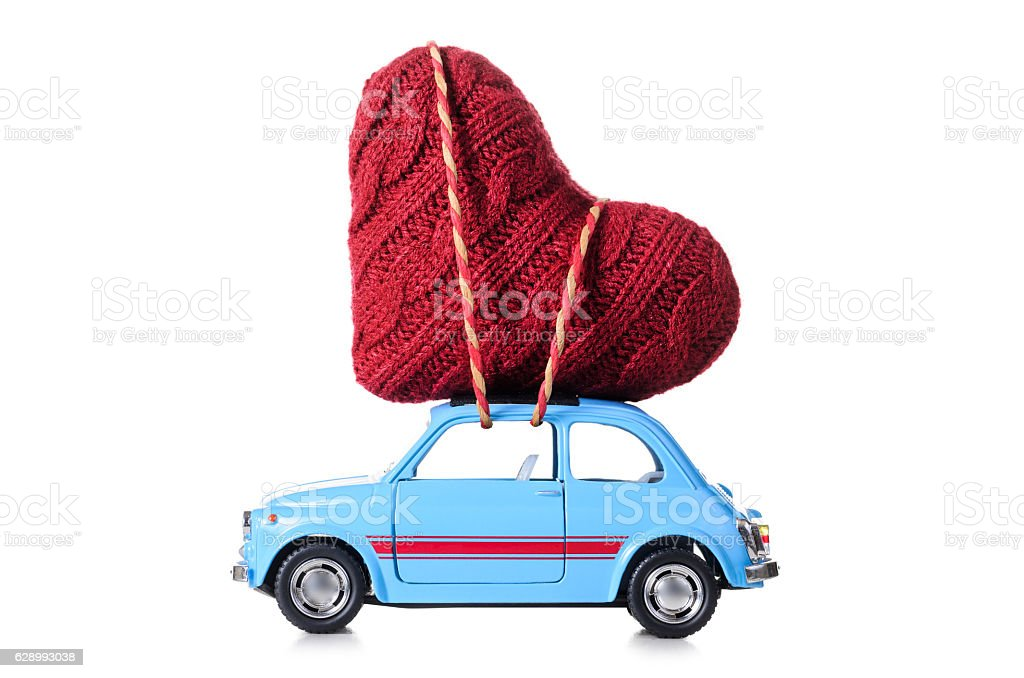 Retro toy car with Valentine heart stock photo