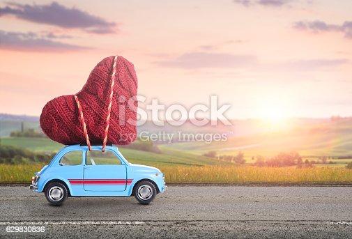 istock Retro toy car with Valentine heart 629830836