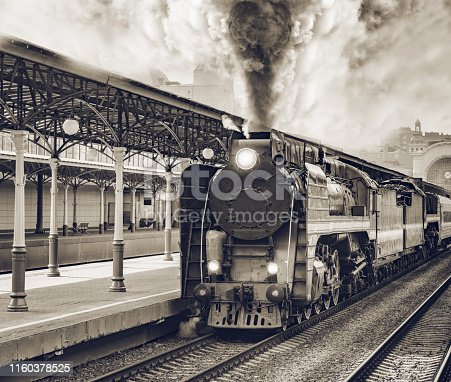 Retro train departs from railway station building. Moscow.
