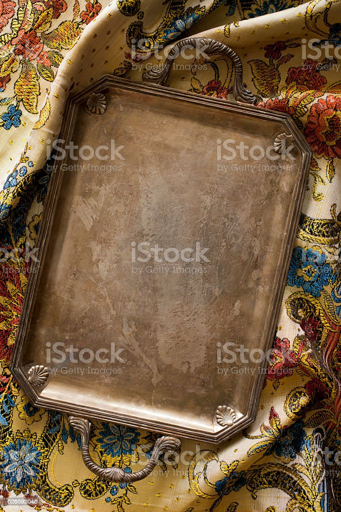 retro tray on oriental tablecloth stock photo