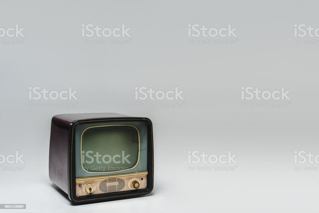 retro tv with blank screen on grey surface royalty-free stock photo