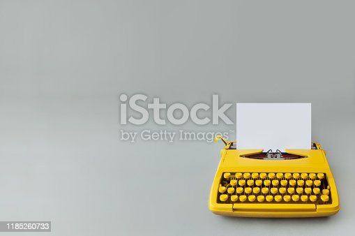 Retro typewriter on a grey paper backdrop