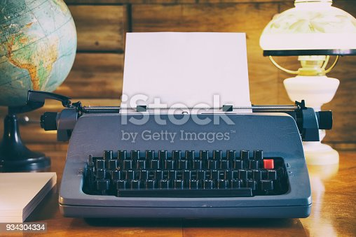 istock Retro typewriter on a wooden table 934304334