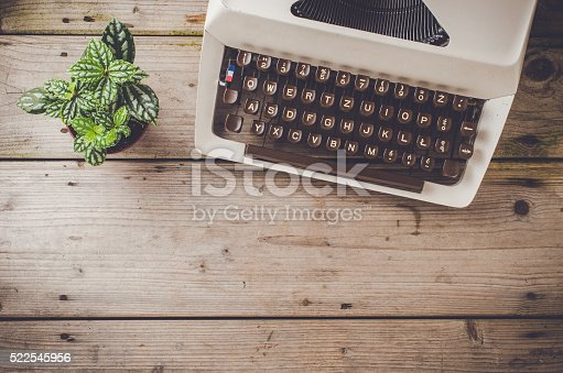 Retro typewriter on an old wooden table