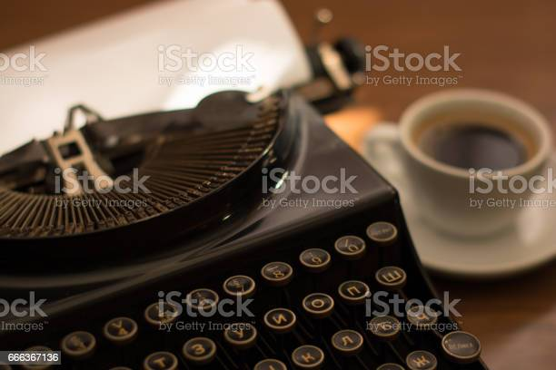 Retro typewriter on writers desk