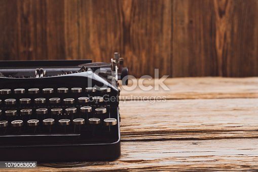 Retro Typewriter on wooden background with space on text