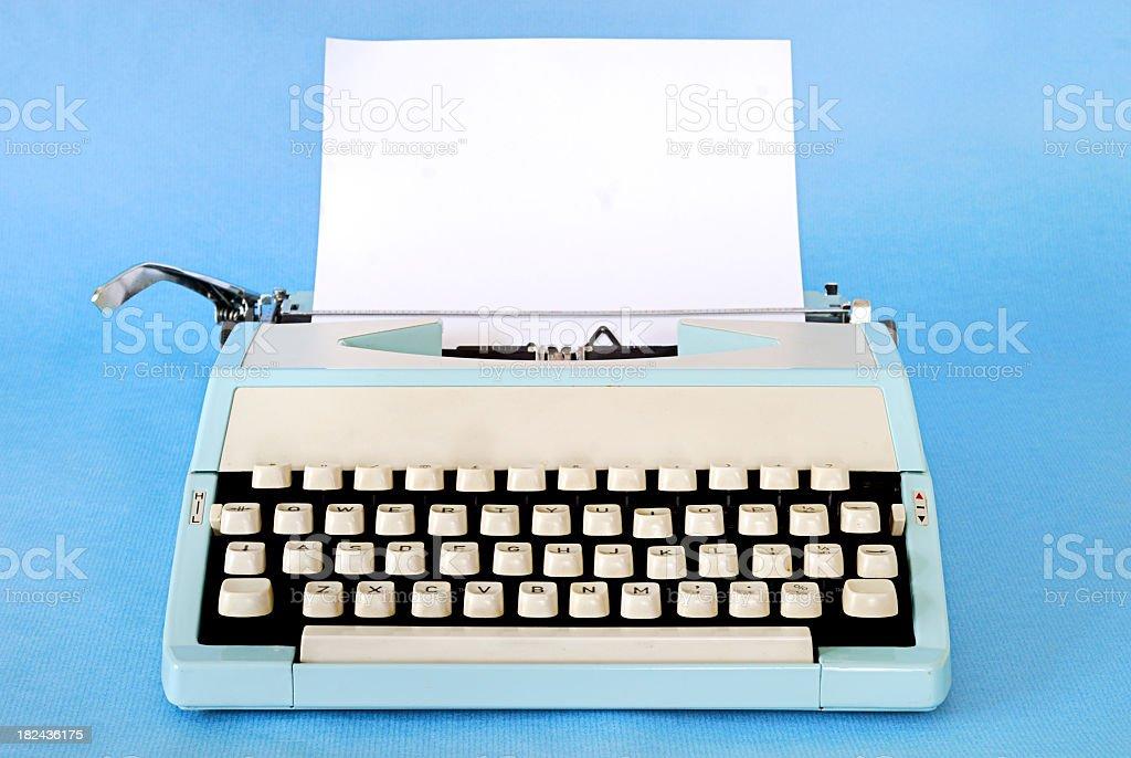 Retro typewriter with blue background royalty-free stock photo