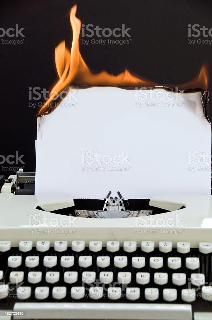 Retro Typewriter With Burning Paper ... Full Keyboard royalty-free stock photo