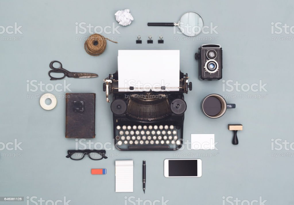 Retro typewriter with old items stock photo