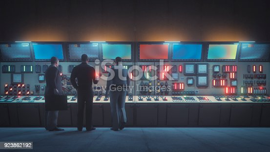 Retro underground control room with men in front of the console.