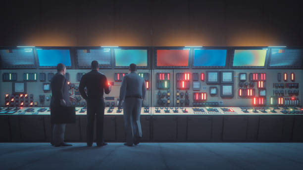 Retro underground control room with men in front of the console stock photo