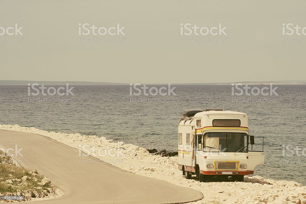 Retro van by the sea on the old photo style stock photo