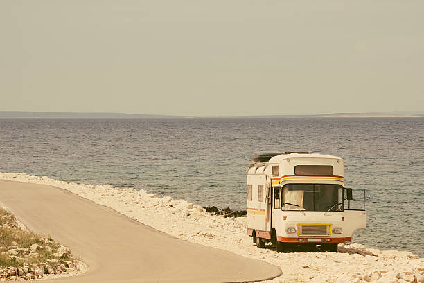 retro van by the sea on the old photo style - 1970s style stock photos and pictures