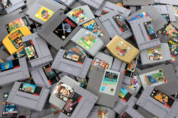 Retro Video Game Cartridge Collection Taipei, Taiwan - February 20, 2018: A studio shot of a heap of retro video games shot from above. nintendo stock pictures, royalty-free photos & images