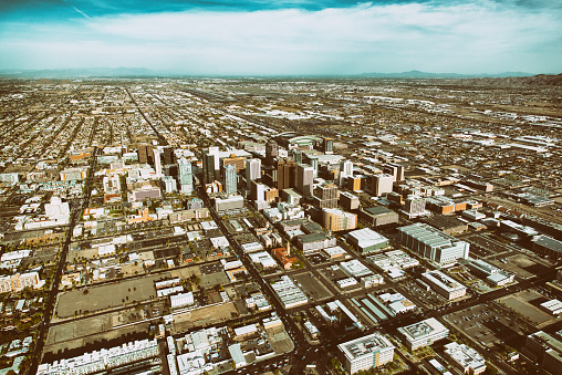 The downtown and surrounding areas of Phoenix, Arizona from about 2000 feet in altitude processed in an aged film method for a retro style.