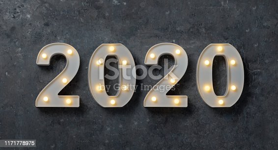 istock Retro, Vintage 2020 with lighting balls number on grey texture background. 1171778975