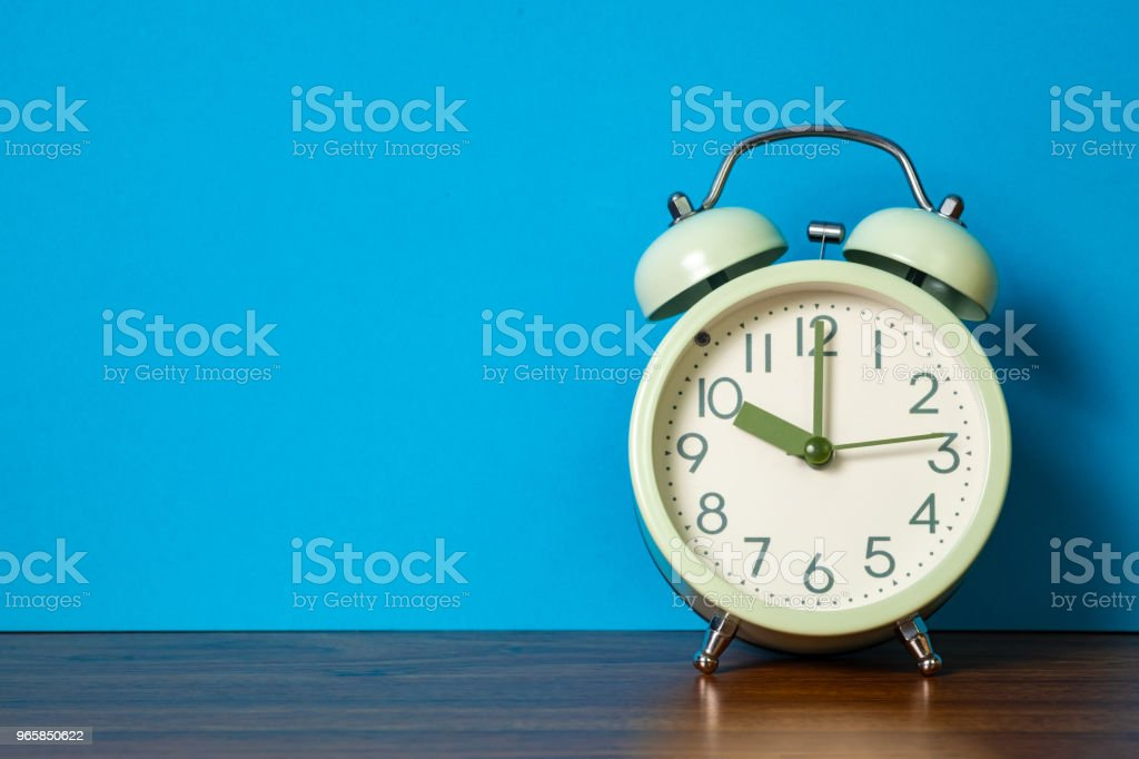 Retro vintage alarm clock on wood table, time concept. - Royalty-free Alarm Stock Photo