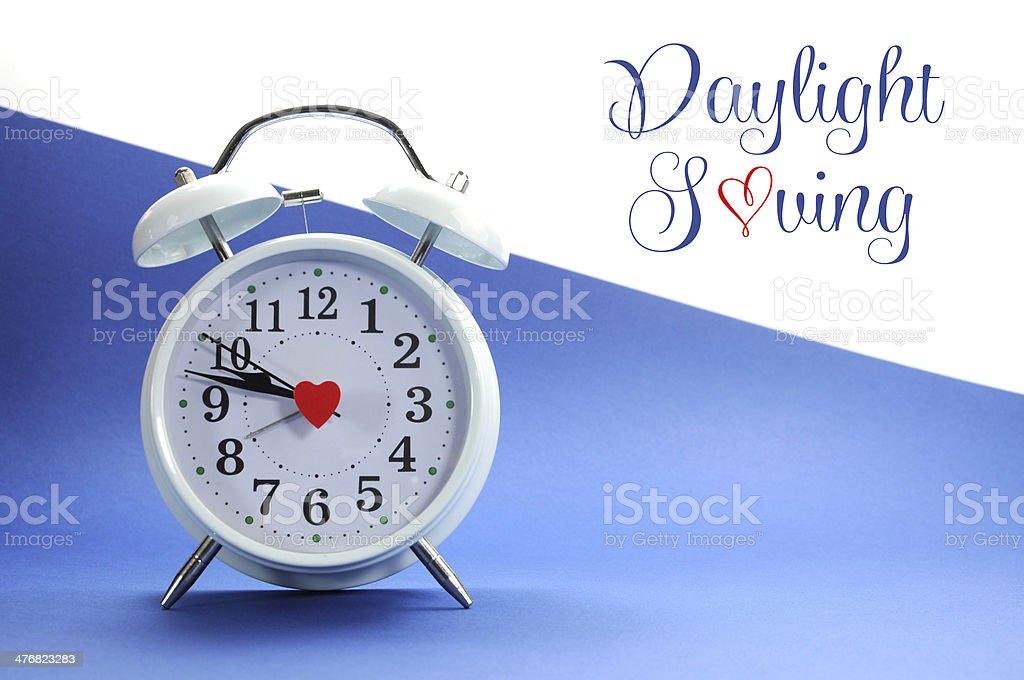 Retro vintage alarm clock with Daylight Saving text stock photo