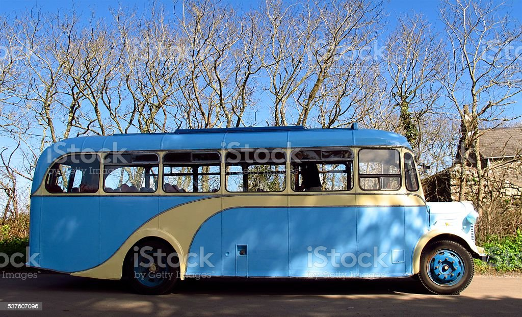 retro vintage bus on rural country road stock photo