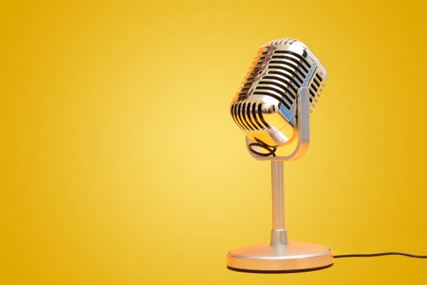 Retro vintage microphone on yellow background studio Retro vintage microphone on yellow background studio. microphone stock pictures, royalty-free photos & images
