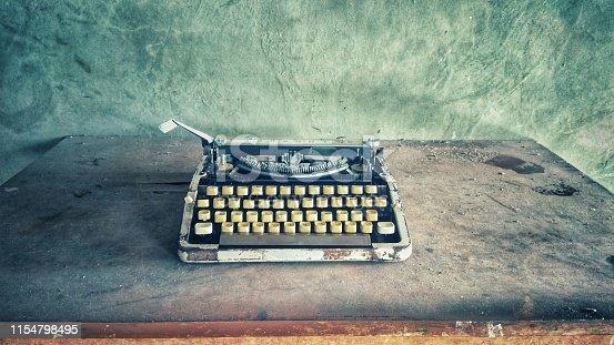 Retro vintage old dusty typewriter industrial style photo