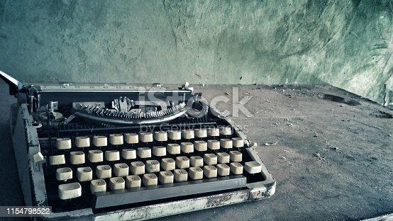 istock Retro vintage old dusty typewriter 1154798522