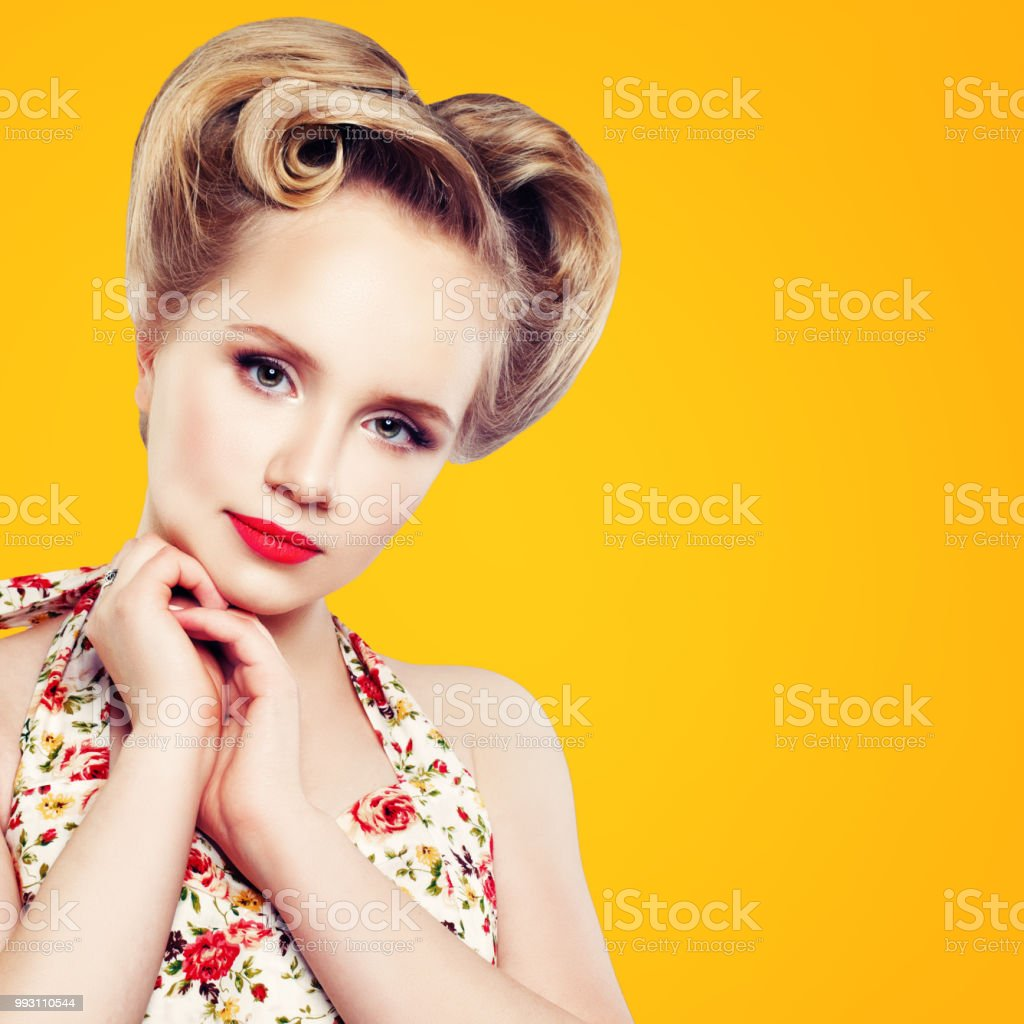 Retro Vintage Pinup Woman With Perfect Updo Hairstyle And Red Lips