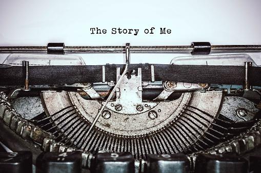 Retro vintage typewriter writes text on old white paper.