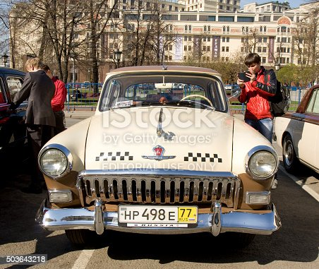 Moscow, Russia – April 27, 2014: Russian retro car Volga GAZ on rally of classical cars on Theatre square, unidentified people on rally.