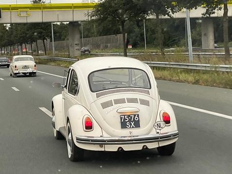 Eindhoven  the Netherlands, - October 02, 2021.  Retro 1970 Volkswagen Beetle on the Dutch highway.