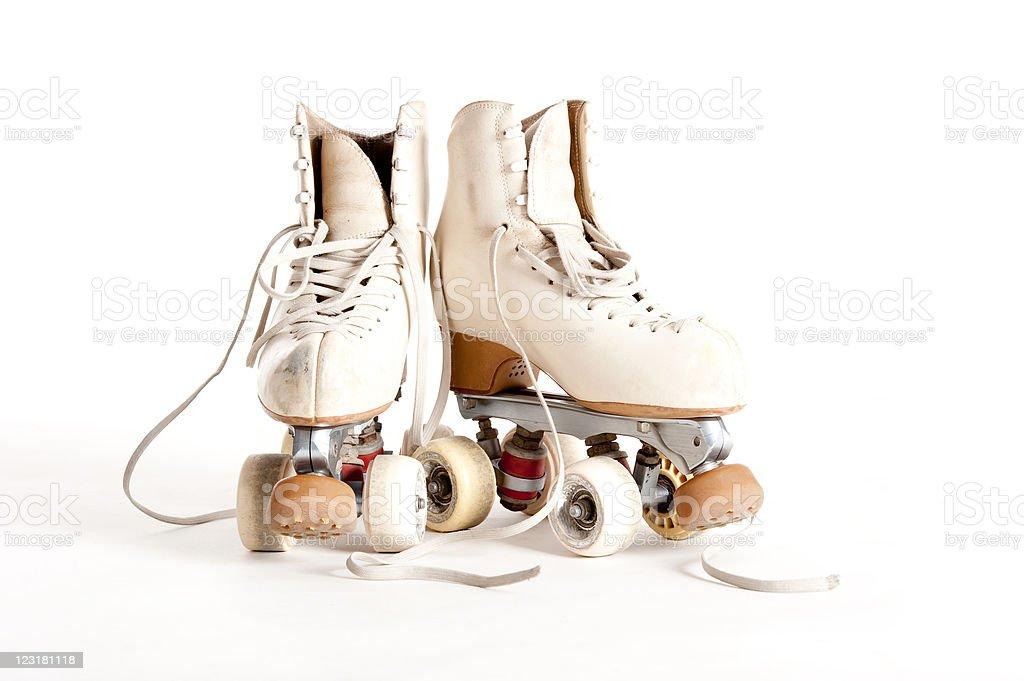 Retro white roller skates on a white background stock photo