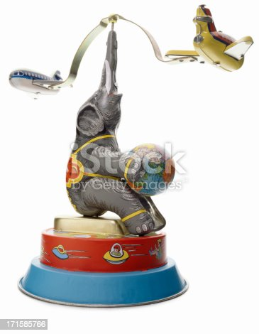 A retro wind-up toy with an elephant and an airplane isolated on white background.