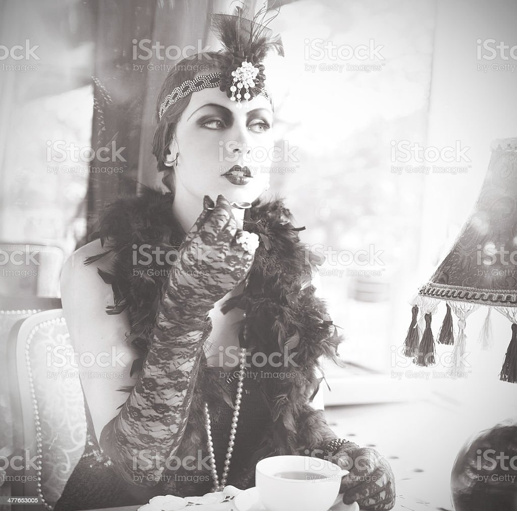 Retro Woman 1920s - 1930s Sitting in the Cafe stock photo
