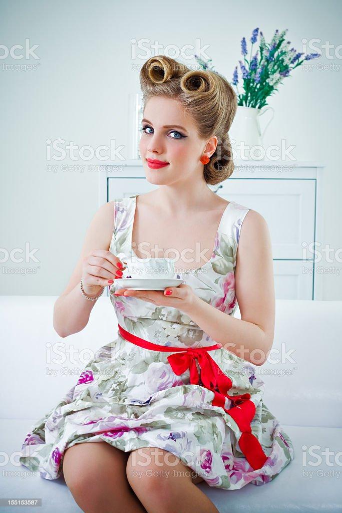 Retro woman drinking coffee stock photo