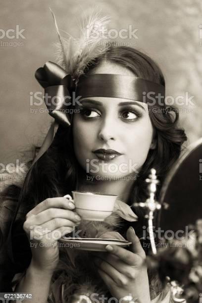 Retro woman drinking coffee